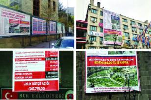 Belediyelerle kayyumların afiş savaşı