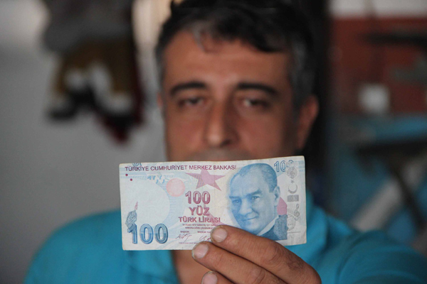 Hatalı basılan banknotu 60 bin liraya satıyor